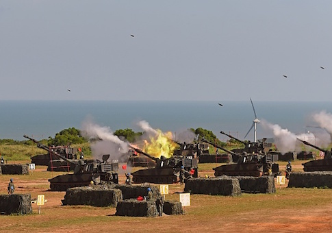Taiwan military soldiers fire artillery shells from 38 eight-inch and 155-millimeter howitzers during the Han Kuang 31 live fire drill in Hsinchu, northern Taiwan