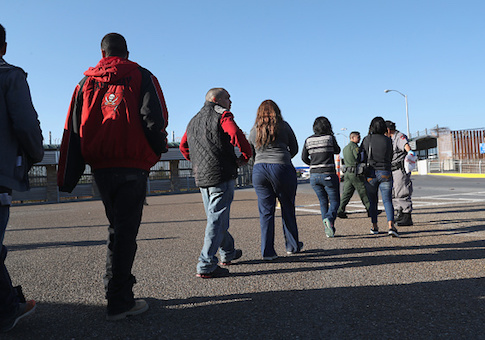 Immigrants are deported across an international bridge into Mexico on March 14, 2017 from Hidalgo, Texas