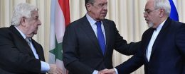Russian Foreign Minister Sergei Lavrov shakes hands with his Iranian counterpart Mohammad Javad Zarif as Syrian Foreign Minister Walid Muallem looks on after a joint press conference