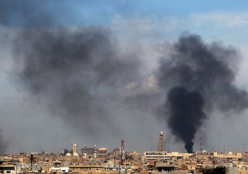 Smoke billows from behind the Great Mosque of al-Nuri in Mosul's Old City on April 17