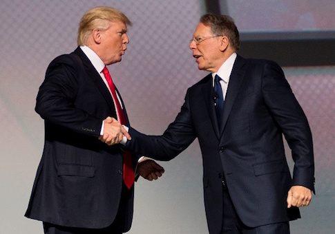US President Donald Trump shakes hands with National Rifle Association (NRA) President Wayne LaPierre