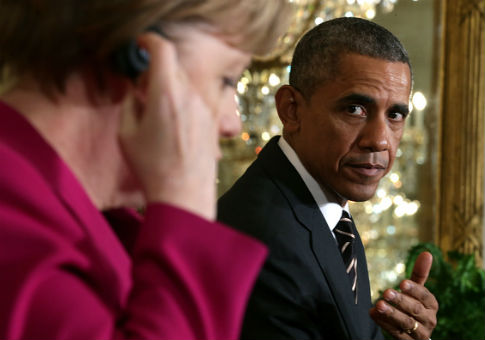 German Chancellor Angela Merkel (L) and former U.S. President Barack Obama / Getty