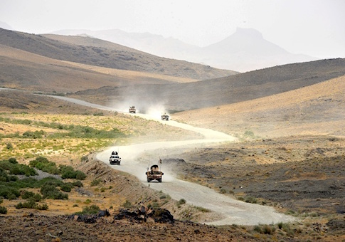 Afghan National Army (ANA) soldiers patrol the Shah Wali Kot district of Kandahar province
