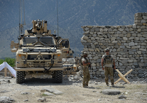 U.S. soldiers patrol near the site of a U.S. bombing during an operation against Islamic State (IS) militants in the Achin district of Afghanistan's Nangarhar province on April 15