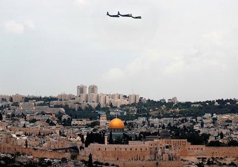 Israeli C-130 transport planes perform a fly over Jerusalem during celebrations marking Israels 69th Independence Day