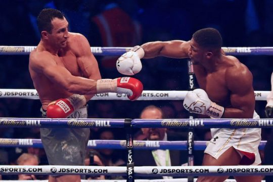 Britain's Anthony Joshua throws a punch at Ukraine's Wladimir Klitschko during the tenth round of their IBF, IBO and WBA, world Heavyweight title fight at Wembley Stadium in north west London