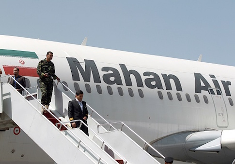 An airplane of Mahan Air sits at the tarmac after landing