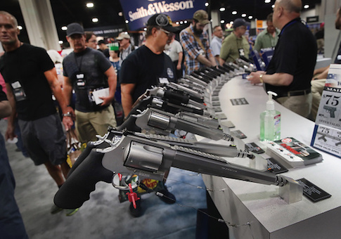 National Rifle Association members look over pistols in the Smith & Wesson display at the 146th NRA Annual Meetings & Exhibits on April 29, 2017 in Atlanta, Georgia