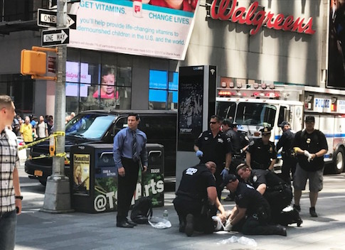 First responders are assisting injured pedestrians after a vehicle struck pedestrians on a sidewalk in Times Square