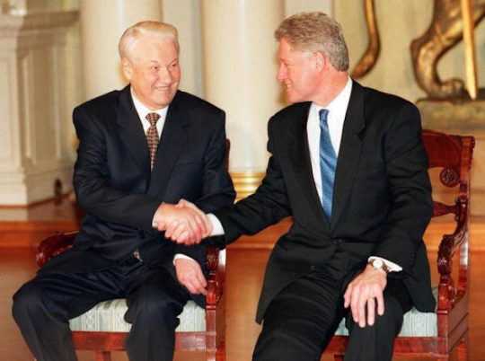 This picture taken in March 1997 shows U.S. President Bill Clinton and Russian President Boris Yeltsin shaking hands at the Presidential Palace