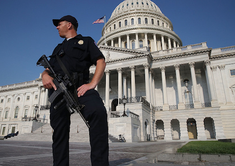 A U.S. Capitol Police officer stands guard in front of the U.S. Capitol Building