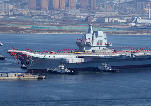 Type 001A, China's second aircraft carrier, is transferred from the dry dock into the water during a launch ceremony at Dalian shipyard