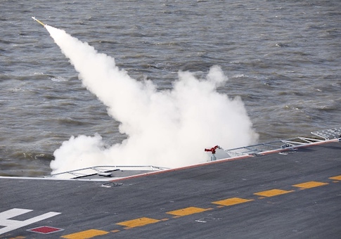 This picture taken on an undisclosed date in December 2016 shows a missile being fired from the Liaoning aircraft carrier during military drills in the Bohai Sea