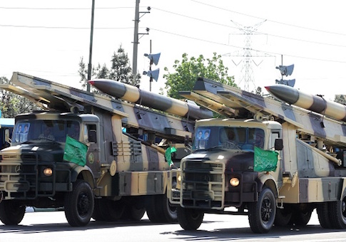 Iranian military trucks carry surface-to-air missiles during a parade on the occasion of the country's Army Day, on April 18