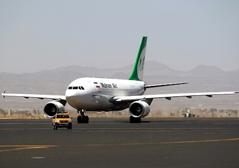 An airplane of Mahan Air sits at the tarmac