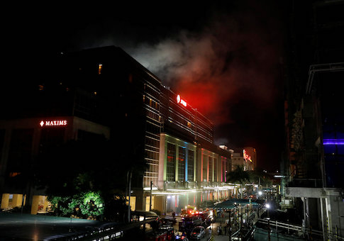 Smoke billows from the Resorts World building in Pasay City, Metro Manila, Philippines