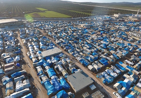 An aerial view shows the Bab al-Salama camp, set up outside the Syrian city of Azaz on Syria's northern border with Turkey