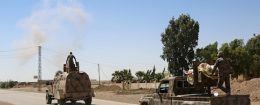 Syrian Democratic Forces made up of an alliance of Kurdish and Arab fighters, drive on the outskirts of an eastern entrance to the Al-Meshleb neighborhood of Raqq
