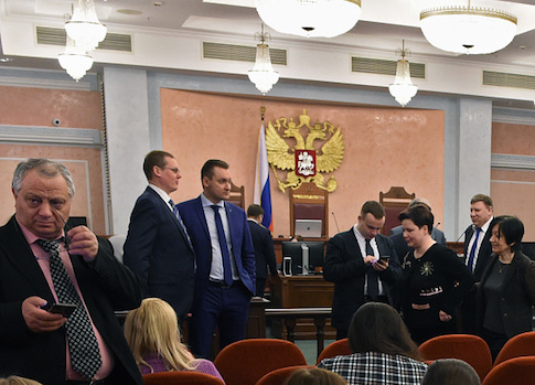 Participants attend a hearing on the justice ministry request to ban the Jehovah's Witnesses at Russia's Supreme Court in Mosco