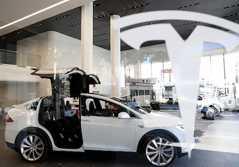 A Tesla Model X is displayed inside of the new Tesla flagship facility