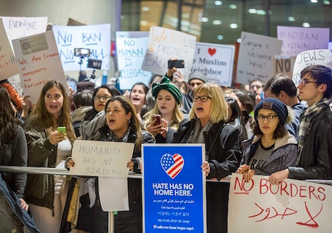 Protestors rally at a demonstration against the new ban on immigration issued by President Trump at Logan International Airport in Boston