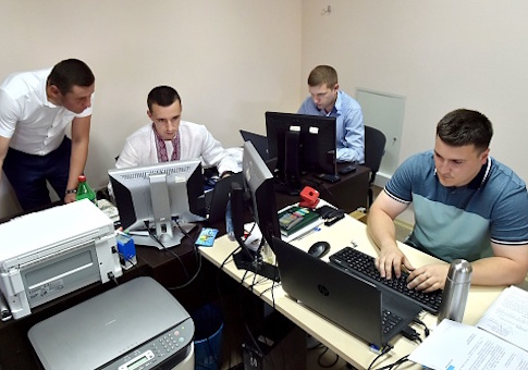 Officers of Ukrainian Cyberpolice Department work in an office in the department building in Kiev