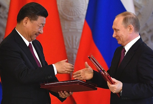 Russian President Vladimir Putin and Chinese counterpart Xi Jinping shake hands