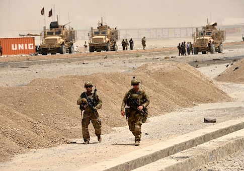 US soldiers walk at the site of a Taliban suicide attack in Kandahar on August 2