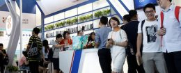People walk past the Cambridge University Press stall at the Beijing International Book Fair