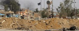 The Islamic State group flag is seen in the town of Heet, in Iraq's Anbar province in 2016