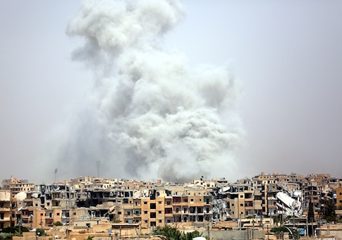Smoke billows out from Raqa following a coalition air strike on July 28