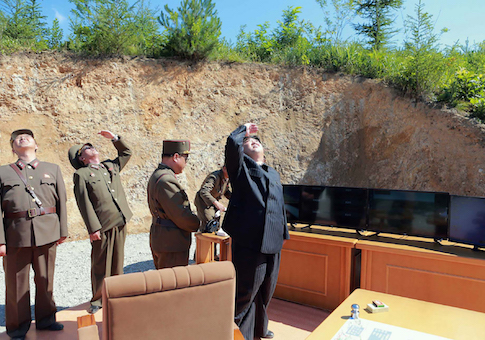 North Korean leader Kim Jong-Un inspects the successful test-fire of the intercontinental ballistic missile Hwasong-14 at an undisclosed location