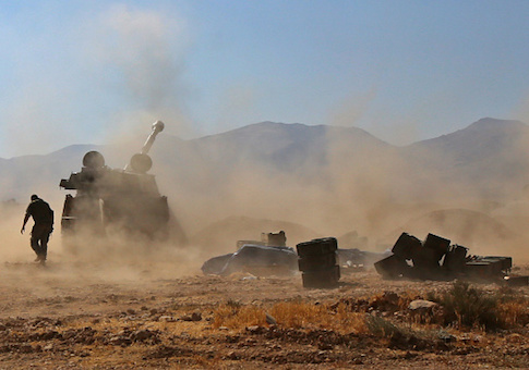 Syrian pro-government forces fire towards jihadist positions, in the western Qalamoun