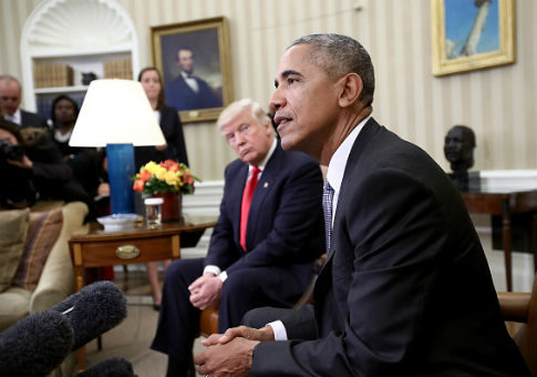 Donald Trump listens as Barack Obama speaks in White House / Getty