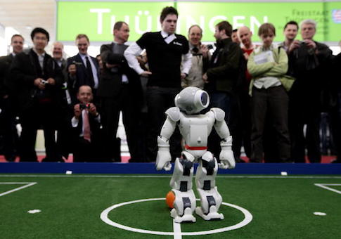 Robots play football in a demonstration of artificial intelligence
