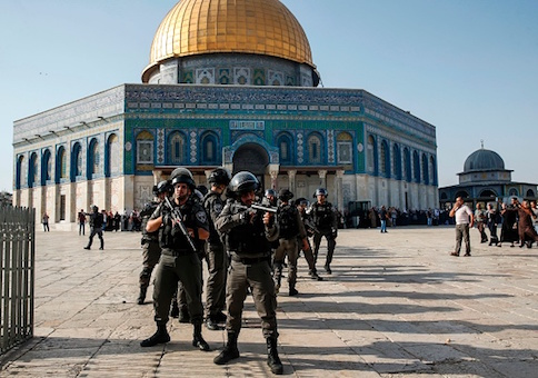 Israeli security forces in front of the Dome of the Rock in the Haram al-Sharif compound in the old city of Jerusalem after clashes erupted between Israeli police and Palestinians