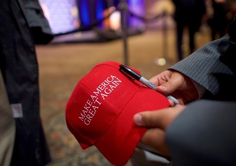 "A supporter holds a ""Make America Great Again"" – MAGA – hat for an autograph, before Republican Presidential nominee Donald Trump holds an event in Gettysburg, Pa. / Getty Images"