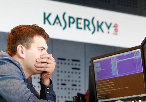 An employee works near screens in the virus lab at the headquarters of Russian cyber security company Kaspersky Labs