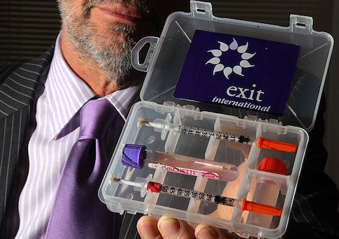 A doctor holds up a drug testing kit which is used as part of assisted suicides
