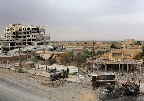 A picture shows the damage on the outskirts of Deir Ez-Zor