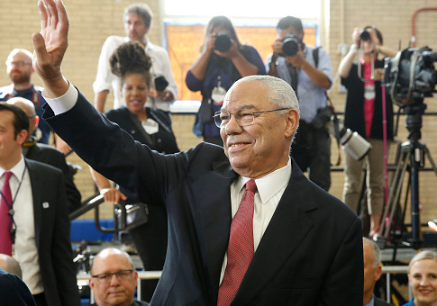 Former US Secretary of State Colin Powell waves before arrival of President Barack Obama at Benjamin Banneker Academic High School in Washington,DC on October 17, 2016. / Getty Images
