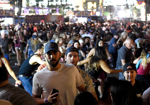 People flee the Route 91 Harvest country music festival grounds / Getty Images