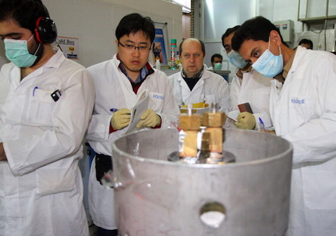 International Atomic Energy Agency inspectors and Iranian technicians at a nuclear power plant of Natanz