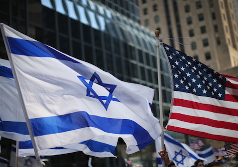 Pro-Israel demonstrators wave flags during a rally in Chicago