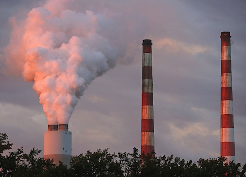 Emissions spew out of a large stack at the coal-fired Morgantown Generating Station on Oct. 10 in Newburg, Maryland / Getty Images