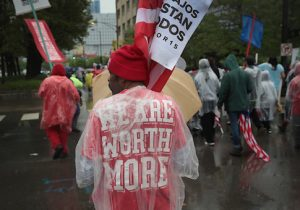Demonstrators fighting for a $15-per-hour minimum wage march