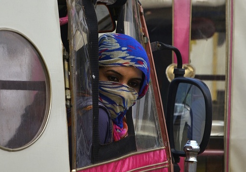 A Pakistani woman looks out from a pink rickshaw at a rally to rise awareness of women's equality and empowerment on Oct. 14, 2017 / Getty Images
