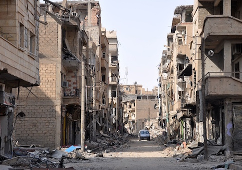 A general view shows damaged buildings in the eastern Syrian city of Deir Ezzor where Syrian and allied forces converged on holdout ISIS fighters