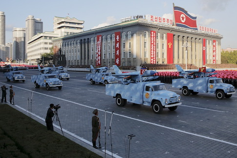 Trucks carry drones under a stand with North Korean leader Kim Jong Un and other officials during the parade celebrating the 70th anniversary of the founding of the ruling Workers' Party of Korea, in Pyongyang