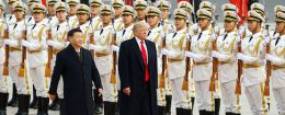 President Donald Trump takes part in a welcoming ceremony with China's President Xi Jinping